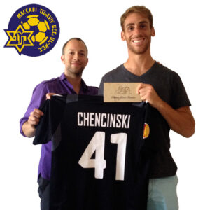Tomer Chencinski With Sign